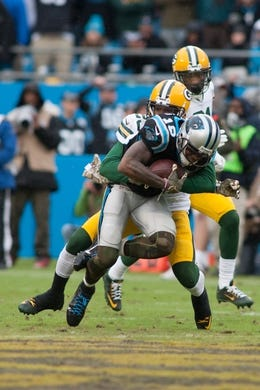 Nov 8, 2015; Charlotte, NC, USA; Carolina Panthers wide receiver Ted Ginn (19) gets tackled by Green Bay Packers cornerback Damarious Randall (23) during the third quarter at Bank of America Stadium. The Panthers defeated the Packers 37-29. Mandatory Credit: Jeremy Brevard-USA TODAY Sports
