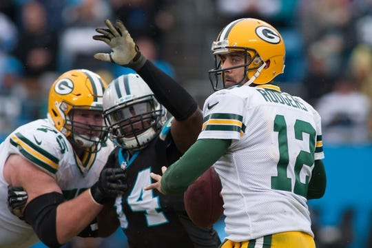 Nov 8, 2015; Charlotte, NC, USA; Carolina Panthers defensive end Kony Ealy (94) applies pressure to Green Bay Packers quarterback Aaron Rodgers (12) during the fourth quarter at Bank of America Stadium. The Panthers defeated the Packers 37-29. Mandatory Credit: Jeremy Brevard-USA TODAY Sports