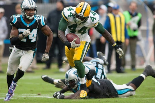 Nov 8, 2015; Charlotte, NC, USA; Green Bay Packers running back James Starks (44) runs the ball during the fourth quarter while Carolina Panthers cornerback Josh Norman (24) pursues at Bank of America Stadium. The Panthers defeated the Packers 37-29. Mandatory Credit: Jeremy Brevard-USA TODAY Sports