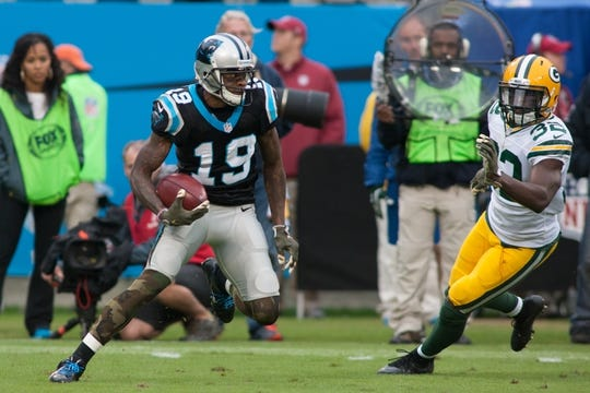 Nov 8, 2015; Charlotte, NC, USA; Carolina Panthers wide receiver Ted Ginn (19) returns a punt during the fourth quarter while Green Bay Packers cornerback Chris Banjo (32) pursues at Bank of America Stadium. The Panthers defeated the Packers 37-29. Mandatory Credit: Jeremy Brevard-USA TODAY Sports