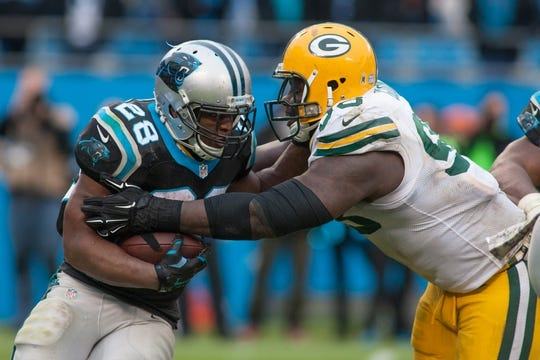 Nov 8, 2015; Charlotte, NC, USA; Carolina Panthers running back Jonathan Stewart (28) runs the ball against Green Bay Packers nose tackle Letroy Guion (98) during the fourth quarter at Bank of America Stadium. The Panthers defeated the Packers 37-29. Mandatory Credit: Jeremy Brevard-USA TODAY Sports