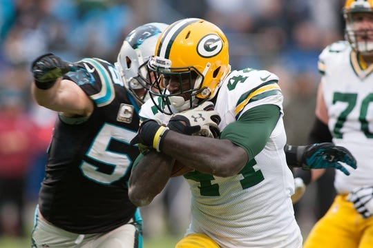 Nov 8, 2015; Charlotte, NC, USA; Green Bay Packers running back James Starks (44) runs the ball past Carolina Panthers middle linebacker Luke Kuechly (59) during the fourth quarter at Bank of America Stadium. The Panthers defeated the Packers 37-29. Mandatory Credit: Jeremy Brevard-USA TODAY Sports