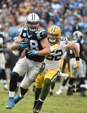 Nov 8, 2015; Charlotte, NC, USA; Carolina Panthers tight end Greg Olsen (88) with the ball as Green Bay Packers inside linebacker Clay Matthews (52) defends in the third quarter at Bank of America Stadium. Mandatory Credit: Bob Donnan-USA TODAY Sports