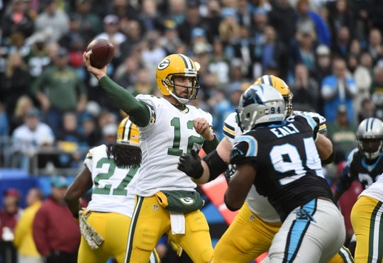 Nov 8, 2015; Charlotte, NC, USA; Green Bay Packers quarterback Aaron Rodgers (12) looks to pass as Carolina Panthers defensive end Kony Ealy (94) pressures in the third quarter at Bank of America Stadium. Mandatory Credit: Bob Donnan-USA TODAY Sports