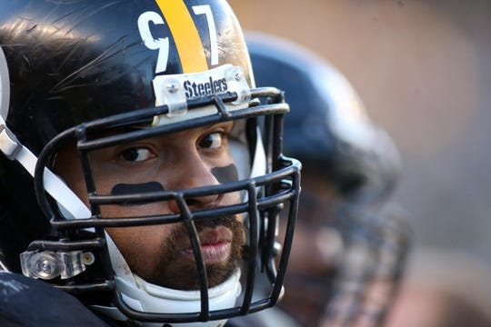 Nov 8, 2015; Pittsburgh, PA, USA; Pittsburgh Steelers defensive end Cameron Heyward (97) looks on against the Oakland Raiders during the fourth quarter at Heinz Field. The Steelers won 38-35. Mandatory Credit: Charles LeClaire-USA TODAY Sports