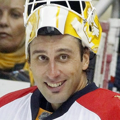 Oct 20, 2015; Pittsburgh, PA, USA; Florida Panthers goalie Roberto Luongo (1) reacts from the bench during a time out against  the Pittsburgh Penguins in the second period at the CONSOL Energy Center. The Penguins won 3-2 in overtime. Mandatory Credit: Charles LeClaire-USA TODAY Sports