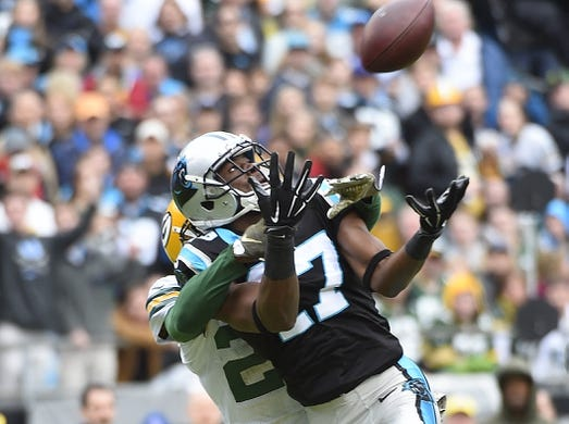 Nov 8, 2015; Charlotte, NC, USA; Carolina Panthers wide receiver Devin Funchess (17) catches a long pass as Green Bay Packers cornerback Damarious Randall (23) defends in the second quarter at Bank of America Stadium. Mandatory Credit: Bob Donnan-USA TODAY Sports