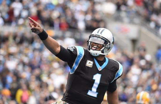 Nov 8, 2015; Charlotte, NC, USA; Carolina Panthers quarterback Cam Newton (1) reacts after throwing a touchdown pass in the second quarter at Bank of America Stadium. Mandatory Credit: Bob Donnan-USA TODAY Sports