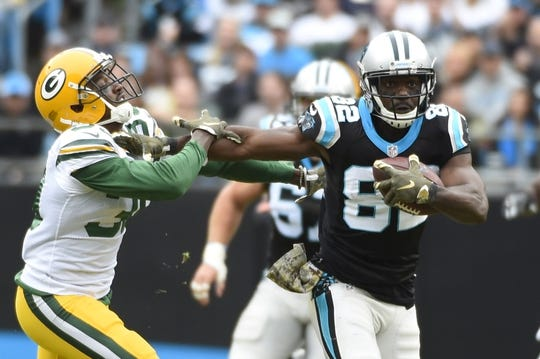 Nov 8, 2015; Charlotte, NC, USA; Carolina Panthers wide receiver Jerricho Cotchery (82) with the ball as Green Bay Packers cornerback Demetri Goodson (39) defends in the second quarter at Bank of America Stadium. Mandatory Credit: Bob Donnan-USA TODAY Sports