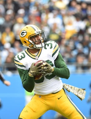 Nov 8, 2015; Charlotte, NC, USA; Green Bay Packers strong safety Micah Hyde (33) receives a punt in the first quarter at Bank of America Stadium. Mandatory Credit: Bob Donnan-USA TODAY Sports
