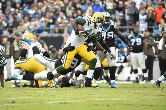 Nov 8, 2015; Charlotte, NC, USA; Green Bay Packers running back James Starks (44) is tackled by Carolina Panthers middle linebacker Luke Kuechly (59) in the first quarter at Bank of America Stadium. Mandatory Credit: Bob Donnan-USA TODAY Sports