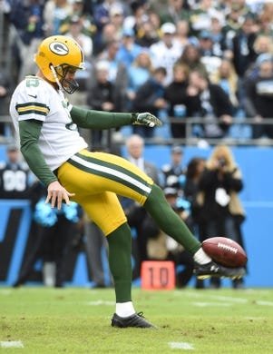 Nov 8, 2015; Charlotte, NC, USA; Green Bay Packers punter Tim Masthay (8) punts in the first quarter at Bank of America Stadium. Mandatory Credit: Bob Donnan-USA TODAY Sports