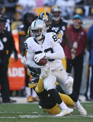 Nov 8, 2015; Pittsburgh, PA, USA; Oakland Raiders wide receiver Amari Cooper (89) runs after a catch as Pittsburgh Steelers cornerback Antwon Blake (41) defends during the second quarter at Heinz Field. The Steelers won 38-35. Mandatory Credit: Charles LeClaire-USA TODAY Sports