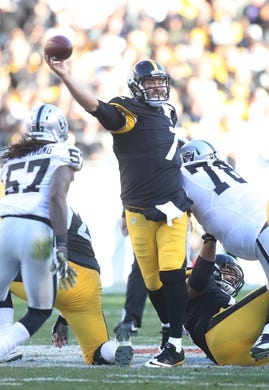 Nov 8, 2015; Pittsburgh, PA, USA; Pittsburgh Steelers quarterback Ben Roethlisberger (7) throws the ball against  pressure from Oakland Raiders defensive tackle Justin Ellis (78) during the third quarter at Heinz Field. The Steelers won 38-35. Mandatory Credit: Charles LeClaire-USA TODAY Sports