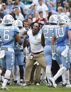 Nov 7, 2015; Chapel Hill, NC, USA; North Carolina Tar Heels assistant coach Larry Porter reacts in the first quarter at Kenan Memorial Stadium. Mandatory Credit: Bob Donnan-USA TODAY Sports