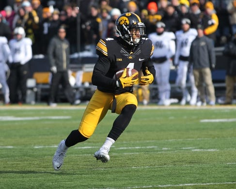 Nov 21, 2015; Iowa City, IA, USA; Iowa Hawkeyes wide receiver Tevaun Smith (4) carries the football against the Purdue Boilermakers in the second quarter at Kinnick Stadium. Mandatory Credit: Reese Strickland-USA TODAY Sports