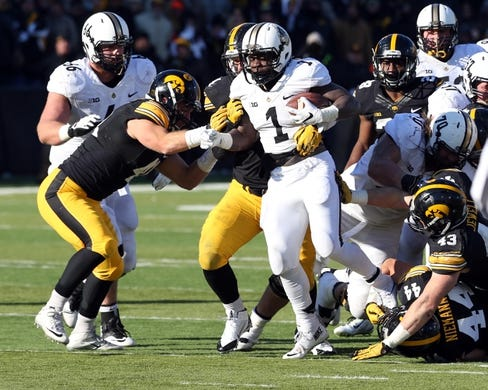 Nov 21, 2015; Iowa City, IA, USA; Purdue Boilermakers running back D.J. Knox (1) is tackled by a group of Iowa Hawkeyes defenders during the third quarter at Kinnick Stadium. Iowa beat Purdue 40-20. Mandatory Credit: Reese Strickland-USA TODAY Sports
