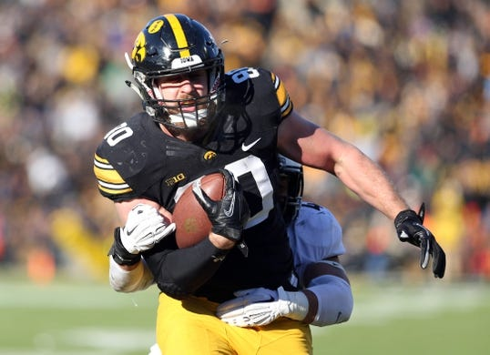 Nov 21, 2015; Iowa City, IA, USA; Iowa Hawkeyes tight end Henry Krieger Coble (80) runs in for a touchdown against the Purdue Boilermakers in the fourth quarter at Kinnick Stadium. Iowa beat Purdue 40-20. Mandatory Credit: Reese Strickland-USA TODAY Sports