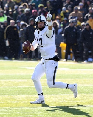 Nov 21, 2015; Iowa City, IA, USA; Purdue Boilermakers quarterback Austin Appleby (12) points downfield against the Iowa Hawkeyes during the fourth quarter at Kinnick Stadium. Iowa beat Purdue 40-20. Mandatory Credit: Reese Strickland-USA TODAY Sports