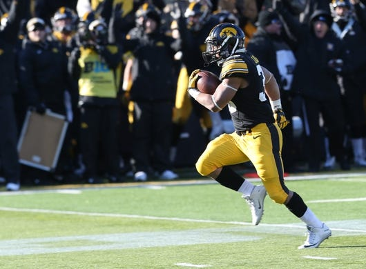 Nov 21, 2015; Iowa City, IA, USA; Iowa Hawkeyes running back Jordan Canzeri (33) carries for a touchdown against the Purdue Boilermakers in the final minutes of the game at Kinnick Stadium.  Iowa beat Purdue 40-20. Mandatory Credit: Reese Strickland-USA TODAY Sports