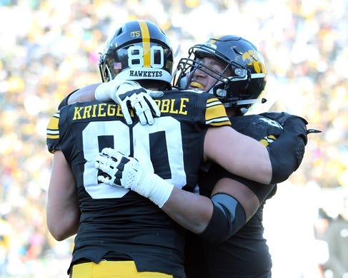 Nov 21, 2015; Iowa City, IA, USA; Iowa Hawkeyes tight end Henry Krieger Coble (80) celebrates after his touchdown with teammate  Matt VandeBerg (89) against the Purdue Boilermakers in the third quarter at Kinnick Stadium. Iowa beat Purdue 40-20. Mandatory Credit: Reese Strickland-USA TODAY Sports