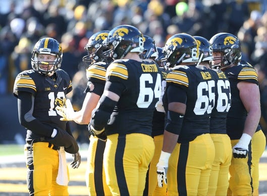 Nov 21, 2015; Iowa City, IA, USA;  Iowa Hawkeyes quarterback C.J. Beathard (16) talks to his team during the third quarter in their game with the Purdue Boilermakers at Kinnick Stadium. Iowa beat Purdue 40-20. Mandatory Credit: Reese Strickland-USA TODAY Sports