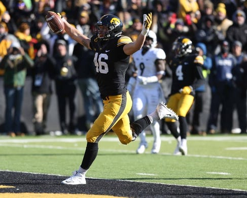 Nov 21, 2015; Iowa City, IA, USA;Iowa Hawkeyes tight end George Kittle (46) celebrates a touchdown catch against the Purdue Boilermakers in the third quarter at Kinnick Stadium. Iowa beat Purdue 40-20. Mandatory Credit: Reese Strickland-USA TODAY Sports