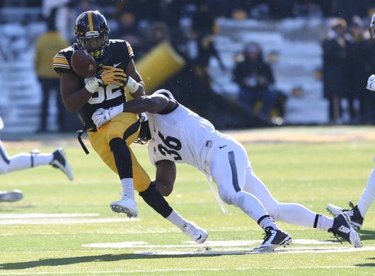 Nov 21, 2015; Iowa City, IA, USA; Iowa Hawkeyes wide receiver Adrian Falconer (82) drops a pass against the Purdue Boilermakers in the third quarter at Kinnick Stadium. Iowa beat Purdue 40-20. Mandatory Credit: Reese Strickland-USA TODAY Sports