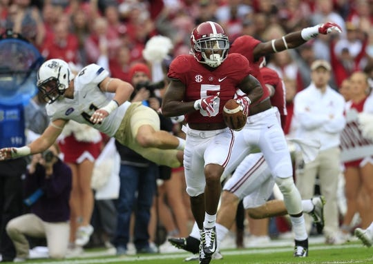 Nov 21, 2015; Tuscaloosa, AL, USA; Alabama Crimson Tide defensive back Cyrus Jones (5) returns a punt for a touchdown against Charleston Southern Buccaneers  at Bryant-Denny Stadium. Mandatory Credit: Marvin Gentry-USA TODAY Sports