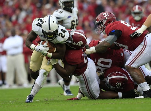 Nov 21, 2015; Tuscaloosa, AL, USA; Alabama Crimson Tide defensive lineman A'Shawn Robinson (86) tackles Charleston Southern Buccaneers running back Darius Hammond (24) at Bryant-Denny Stadium. Mandatory Credit: Marvin Gentry-USA TODAY Sports