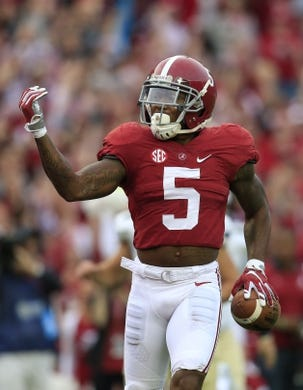 Nov 21, 2015; Tuscaloosa, AL, USA; Alabama Crimson Tide defensive back Cyrus Jones (5) celebrates after returning  a punt for a touchdown against Charleston Southern Buccaneers  at Bryant-Denny Stadium. Mandatory Credit: Marvin Gentry-USA TODAY Sports