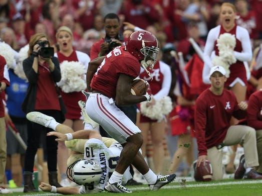 Nov 21, 2015; Tuscaloosa, AL, USA;  Charleston Southern Buccaneers quarterback Kyle Copeland (19) tries to tackle Alabama Crimson Tide defensive back Cyrus Jones (5) after he intercepted a pitch at Bryant-Denny Stadium. Mandatory Credit: Marvin Gentry-USA TODAY Sports