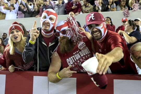 Nov 21, 2015; Tuscaloosa, AL, USA; Alabama Crimson Tide fans celebrate the Tides 56-6 win against the Charleston Southern Buccaneers at Bryant-Denny Stadium. Mandatory Credit: Marvin Gentry-USA TODAY Sports