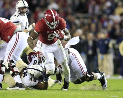 Nov 21, 2015; Tuscaloosa, AL, USA;  Alabama Crimson Tide running back Bo Scarbrough (9) carries the ball against the Charleston Southern Buccaneers at Bryant-Denny Stadium. Mandatory Credit: Marvin Gentry-USA TODAY Sports