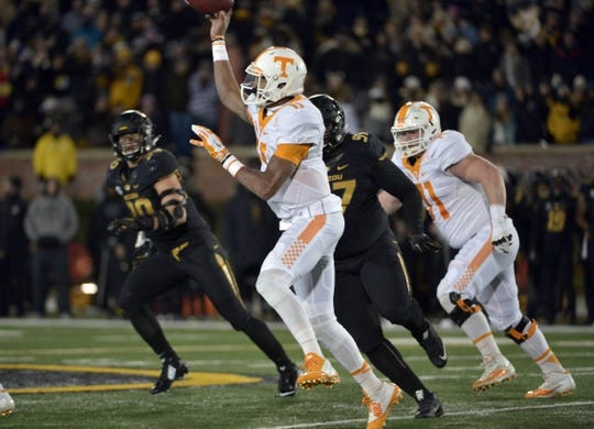 Nov 21, 2015; Columbia, MO, USA; Tennessee Volunteers quarterback Joshua Dobbs (11) throws a pass during the first half against the Missouri Tigers at Faurot Field. Mandatory Credit: Denny Medley-USA TODAY Sports