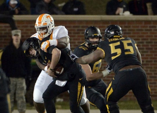 Nov 21, 2015; Columbia, MO, USA; Missouri Tigers quarterback Drew Lock (3) is sacked by Tennessee Volunteers defensive lineman Kahlil McKenzie (1) during the first half at Faurot Field. Mandatory Credit: Denny Medley-USA TODAY Sports