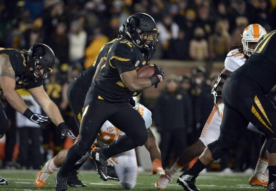 Nov 21, 2015; Columbia, MO, USA; Missouri Tigers running back Russell Hansbrough (32) runs the ball during the first half against the Tennessee Volunteers at Faurot Field. Mandatory Credit: Denny Medley-USA TODAY Sports