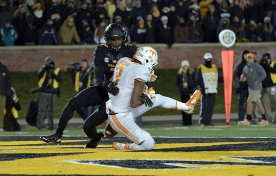 Nov 21, 2015; Columbia, MO, USA; Missouri Tigers defensive back Kenya Dennis (7) breaks up a pass intended for Tennessee Volunteers wide receiver Josh Malone (3) during the first half at Faurot Field. Mandatory Credit: Denny Medley-USA TODAY Sports
