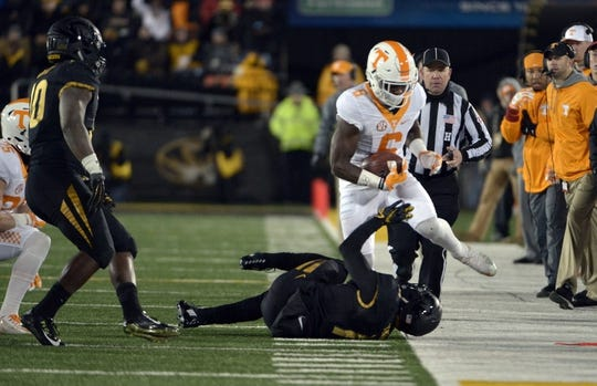 Nov 21, 2015; Columbia, MO, USA; Tennessee Volunteers running back Alvin Kamara (6) runs the ball and is pushed out of bounds by Missouri Tigers cornerback Aarion Penton (11) during the first half at Faurot Field. Mandatory Credit: Denny Medley-USA TODAY Sports