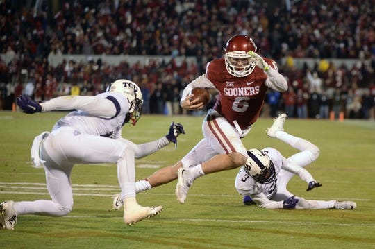 Nov 21, 2015; Norman, OK, USA; Oklahoma Sooners quarterback Baker Mayfield (6) scrambles out of the pocket while being pursued by TCU Horned Frogs cornerback Torrance Mosley (3) at Gaylord Family - Oklahoma Memorial Stadium. Mandatory Credit: Mark D. Smith-USA TODAY Sports