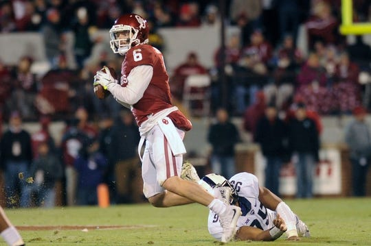 Nov 21, 2015; Norman, OK, USA; Oklahoma Sooners quarterback Baker Mayfield (6) scrambles with the ball while being pursued by TCU Horned Frogs defensive end Breylin Mitchell (96) during the second quarter at Gaylord Family - Oklahoma Memorial Stadium. Mandatory Credit: Mark D. Smith-USA TODAY Sports