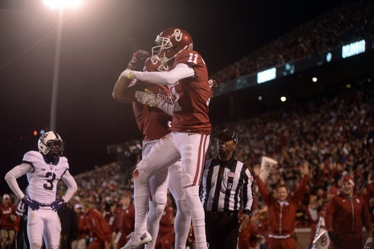 Nov 21, 2015; Norman, OK, USA; Oklahoma Sooners wide receiver Dede Westbrook (11) and Oklahoma Sooners wide receiver Sterling Shepard (3) celebrate in the endzone after a touchdown against the TCU Horned Frogs during the second quarter at Gaylord Family - Oklahoma Memorial Stadium. Mandatory Credit: Mark D. Smith-USA TODAY Sports