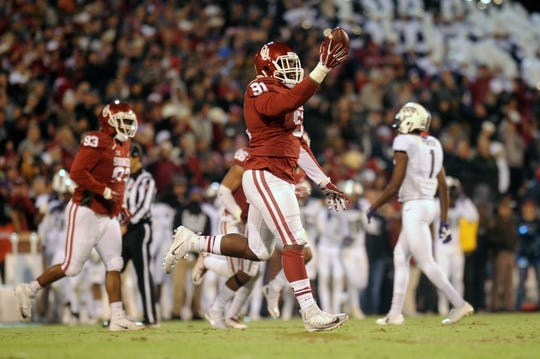 Nov 21, 2015; Norman, OK, USA; Oklahoma Sooners defensive end Charles Tapper (91) celebrates after recovering a fumble against the TCU Horned Frogs during the second quarter at Gaylord Family - Oklahoma Memorial Stadium. Mandatory Credit: Mark D. Smith-USA TODAY Sports