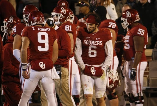 Nov 21, 2015; Norman, OK, USA; Oklahoma Sooners quarterback Baker Mayfield (6) stands on the sidelines without a helmet behind quarterback Trevor Knight (9)during the second half against the TCU Horned Frogs at Gaylord Family - Oklahoma Memorial Stadium. Mandatory Credit: Kevin Jairaj-USA TODAY Sports