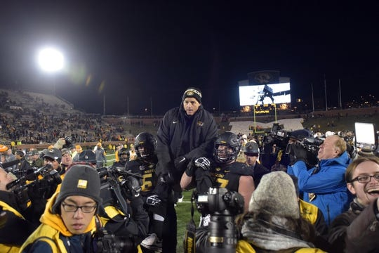 Nov 21, 2015; Columbia, MO, USA; Missouri Tigers head coach Gary Pinkel is carried off the field by Missouri Tigers offensive lineman Evan Boehm (77) and offensive lineman Connor McGovern (60) after the game against the Tennessee Volunteers at Faurot Field. Tennessee won the game 19-8. Mandatory Credit: Denny Medley-USA TODAY Sports