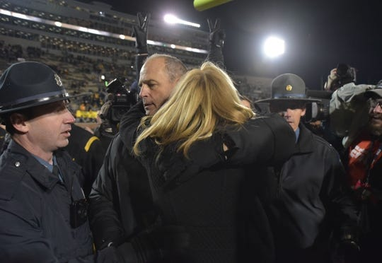 Nov 21, 2015; Columbia, MO, USA; Missouri Tigers head coach Gary Pinkel hugs his wife Missy Martinette while leaving the field after the game against the Tennessee Volunteers at Faurot Field. Tennessee won the game 19-8. Mandatory Credit: Denny Medley-USA TODAY Sports