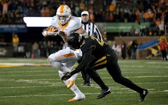 Nov 21, 2015; Columbia, MO, USA; Tennessee Volunteers running back Jalen Hurd (1) runs the ball as Missouri Tigers defensive back Anthony Sherrils (22) attempts the tackle during the second half at Faurot Field. Tennessee won the game 19-8. Mandatory Credit: Denny Medley-USA TODAY Sports