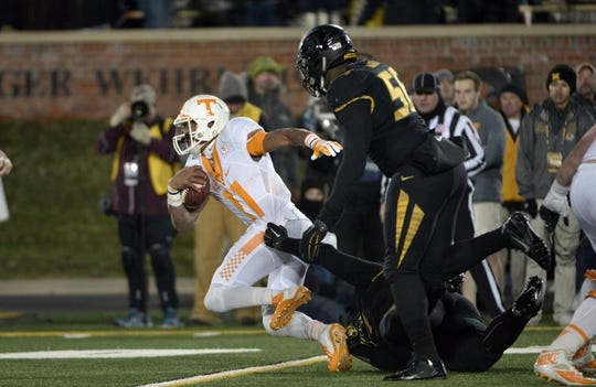 Nov 21, 2015; Columbia, MO, USA; Tennessee Volunteers quarterback Joshua Dobbs (11) runs the ball and is tackled by Missouri Tigers defensive lineman Josh Augusta (97) during the second half at Faurot Field. Tennessee won the game 19-8. Mandatory Credit: Denny Medley-USA TODAY Sports