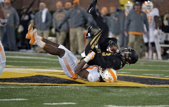 Nov 21, 2015; Columbia, MO, USA; Missouri Tigers defensive back Cam Hilton (33) is tackled by Tennessee Volunteers linebacker Jalen Reeves-Maybin (21) during the second half at Faurot Field. Tennessee won the game 19-8. Mandatory Credit: Denny Medley-USA TODAY Sports