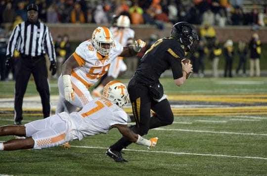 Nov 21, 2015; Columbia, MO, USA; Missouri Tigers quarterback Drew Lock (3) runs the ball and is tripped up by Tennessee Volunteers defensive back Cameron Sutton (7) during the second half at Faurot Field. Tennessee won the game 19-8. Mandatory Credit: Denny Medley-USA TODAY Sports